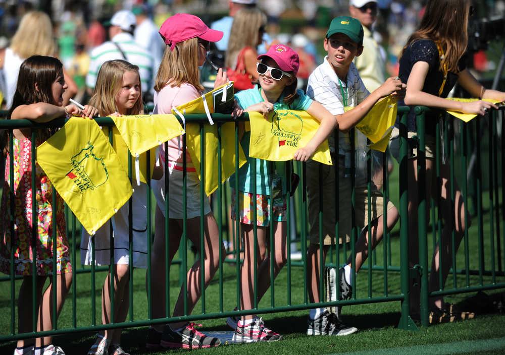 Autograph area lets children get close to golf idols