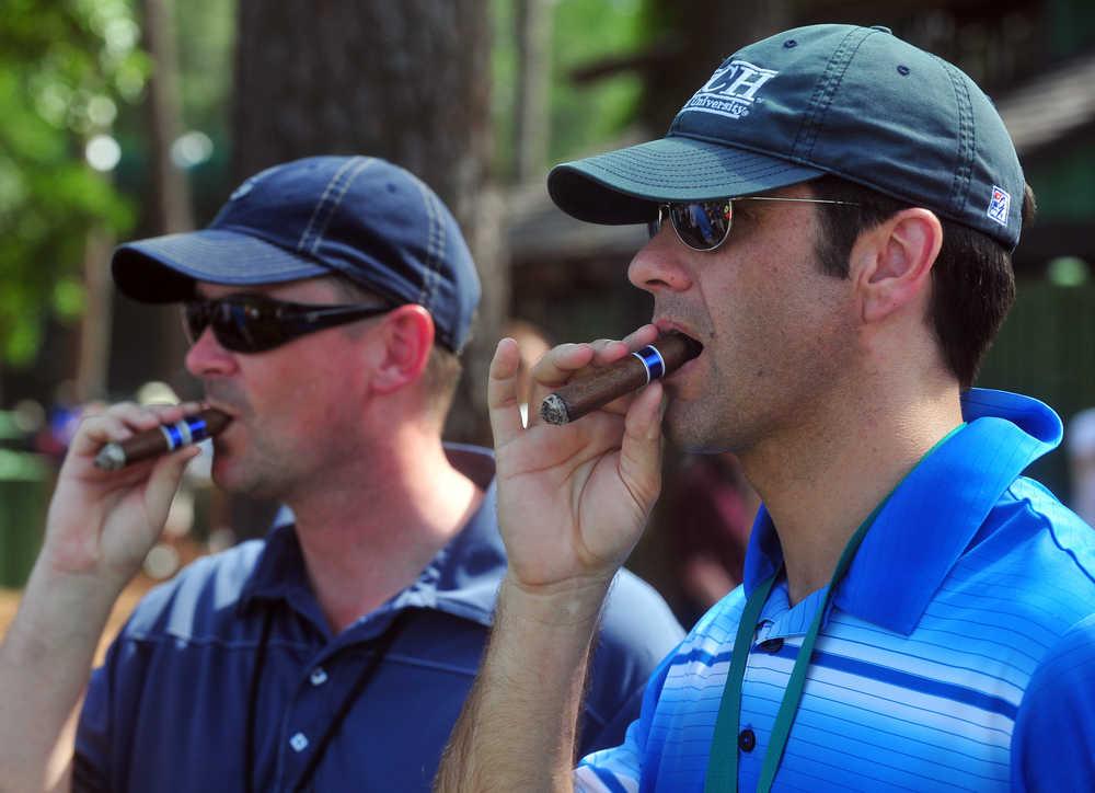 Cigar smoking at Masters still in fashion, but less so