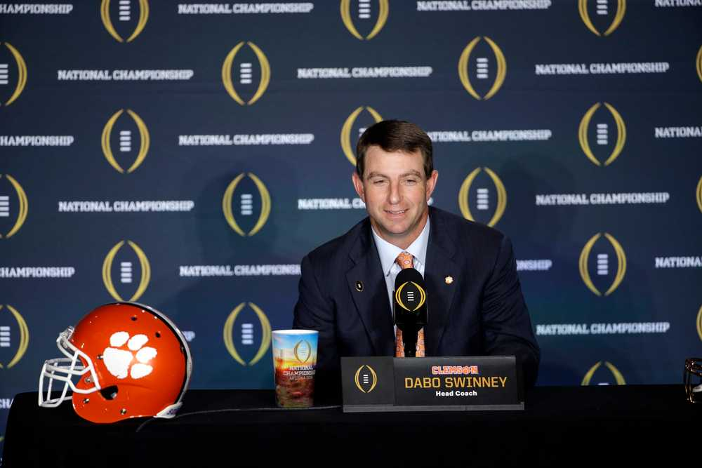 Clemson's Swinney recalls run-in with guard, time playing at Augusta National