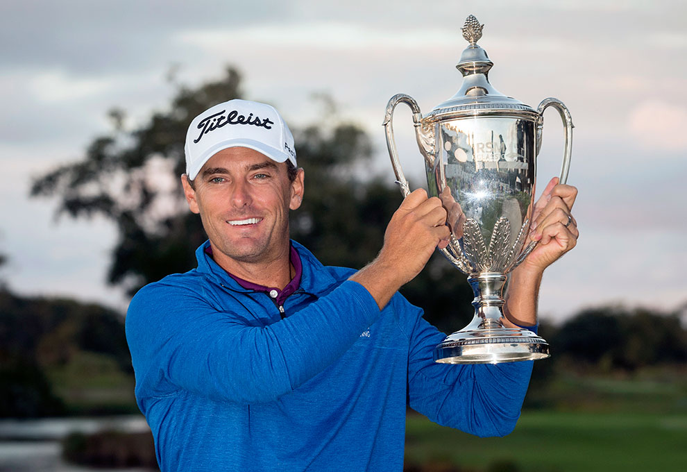 Charles Howell III holds the trophy after winning the RSM Classic golf tournament in a playoff, Sunday, Nov. 18, 2018, in St. Simons Island, Ga. (AP Photo/Stephen B. Morton)